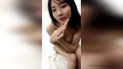 fledgling asian MODEL is posing bare in bed for extra MONEY
